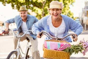 older-couple-riding-bikes