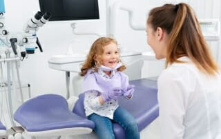 image of little girl with dentist