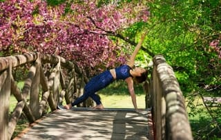 woman-excersizing-on-bridge